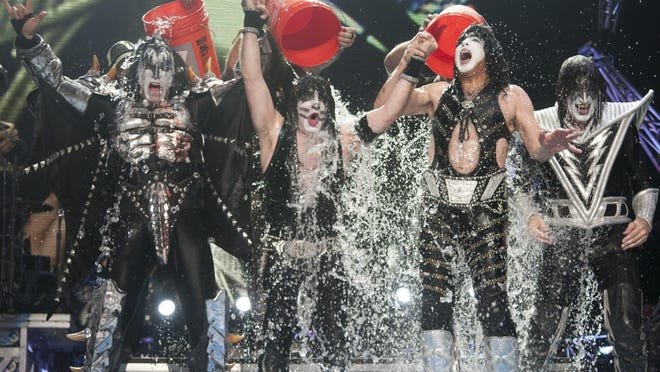 The members of Kiss (from left, Gene Simmons, Eric Singer, Paul Stanley and Tommy Thayer) are doused on Friday at Klipsch Music Center.