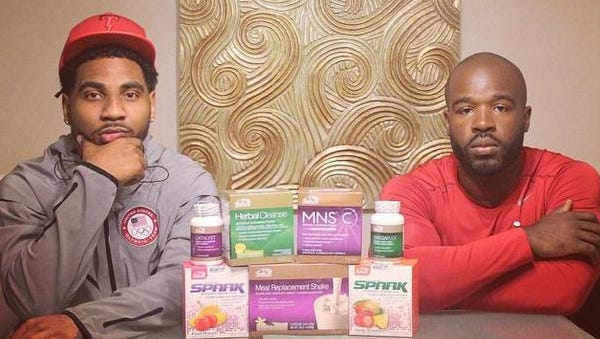 Braxton Miller, left, poses with AdvoCare products.