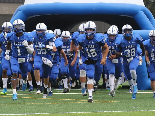 And here come the Salem Rocks through the tunnel to start their first home game of 2015. Walled Lake Western won Friday afternoon's game at P-CEP.