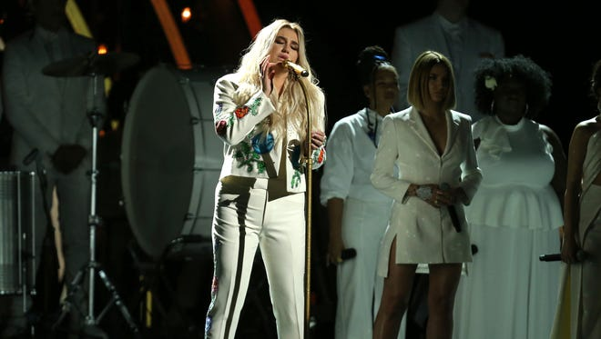 "Kesha performs ""Praying"" at the 60th annual Grammy Awards at Madison Square Garden on Sunday, Jan. 28, 2018, in New York."