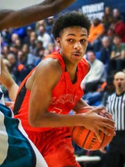 Blackman's Donovan Sims drives into the lane during Friday's game at Siegel.