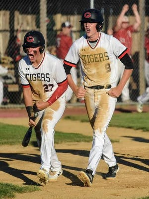 Eli Eldred, left, Owen Blumhagen and the rest of the sixth-ranked Gilbert baseball team is full of confidence heading into Friday's Class 3A state baseball semifinal game against fourth-ranked Dallas Center-Grimes (18-3). The Tigers (22-3) haven't given up a run yet during the postseason. Friday's semifinal game will be at 10:30 a.m. at Principal Park in Des Moines. File photo by Joe Randleman/Ames Tribune