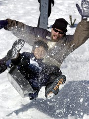Corey Hoover and his son Christopher at the Wolverton snow play area in Sequoia National Park.