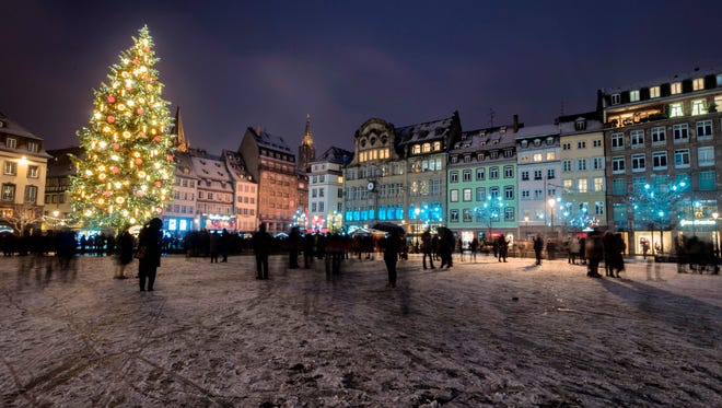 A light layer of snow covers the Place Kleber square in downtown Strasbourg, France, where a giant Christmas tree is displayed for the  2017holiday season.