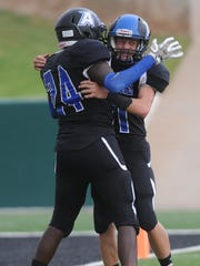 Abilene Christian High's Jason Massey, left, celebrates with Jeremiah Presley after Presley returned an interception four yards for the game's first score. The Panthers beat Weatherford Christian 36-8 in the Champions Classic finale Saturday, Sept. 2, 2017 at Shotwell Stadium.