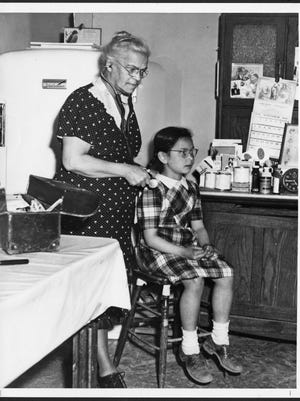 "Dr. Rosa Minoka-Hill treats a patient in her ""kitchen clinic"" during the 1940's on the Oneida reservation near Green Bay."