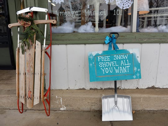 A shovel and a vintage sled sit outside Vintage Market 101 Thursday in downtown St. Joseph.