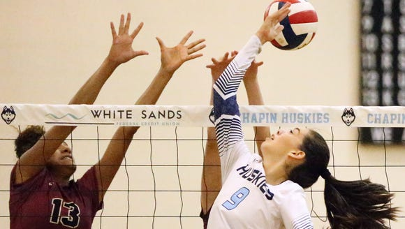 Chapin's Amber Soto, 9, hits the ball behind her in