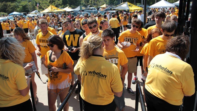 University of Iowa students enter Kinnick Stadium for the game against Northern Illinois on Aug. 31. 2013.