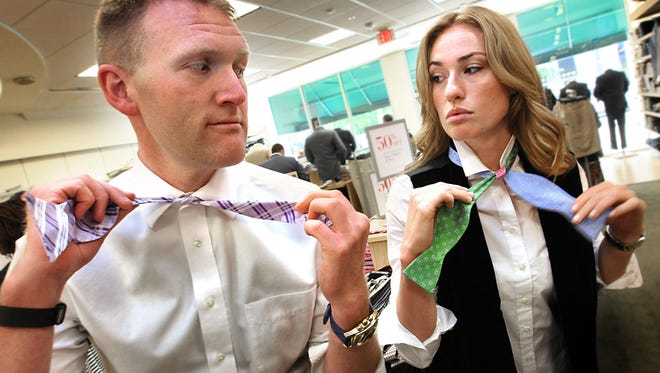 "Rock Your Bow Tie CEO, Cris Dorman, works with model, Jade Brownfield, during the ""Tie One On With The Indy Star"" event."