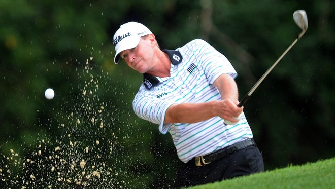 Steve Stricker hits out of a bunker during the second round of the 2014 PGA Championship golf tournament at Valhalla Golf Club in August.