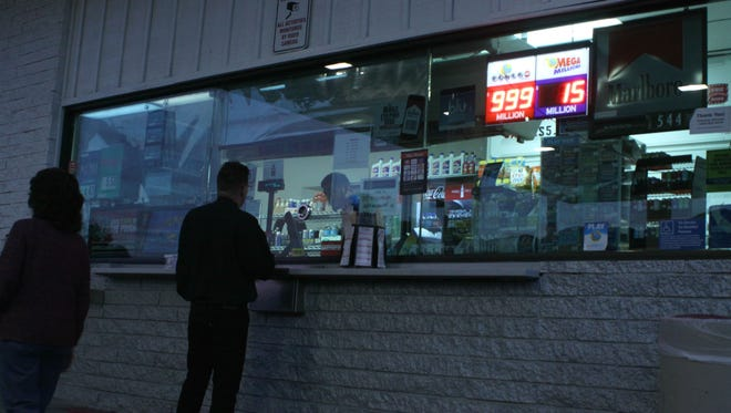 A line formed outside a 76 gas station in Palm Springs on Monday evening as residents purchased tickets for the California Lottery's Powerball, with a jackpot now set at $1.4 million.