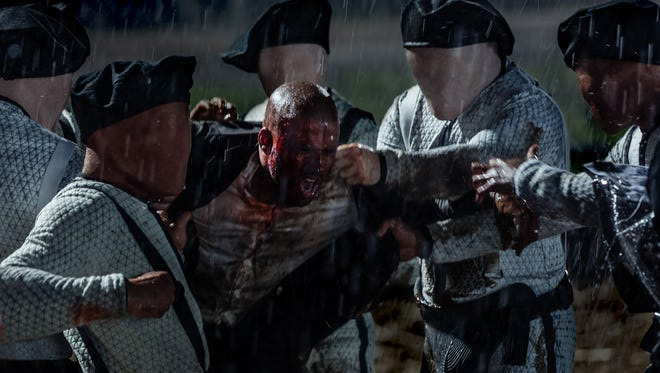 Shadow Moon (center, Ricky Whittle) is attacked by the New Gods' faceless goons in 'American Gods.'