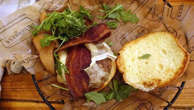 Apple and brie burger with honey glazed apples, brie cheese, arugula and bacon at Arizona Wilderness Brewing Co. in Gilbert, AZ.
