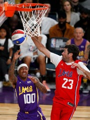 Bubba Watson, right, blocks a shot by musician Nick Cannon during the NBA All-Star Celebrity game at Staples Center in Los Angeles on Friday night.