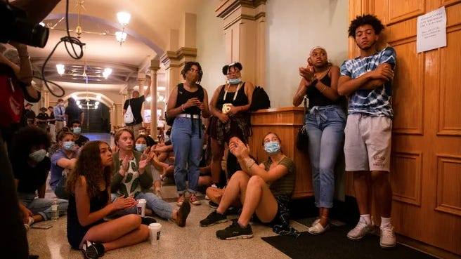 Protestors wait outside Kim Reynold's staff offices at the state Capitol on June 12, 2020. Members planned to ask the governor later that morning to pass an executive order to restore felon voting rights to felons after completing sentences.