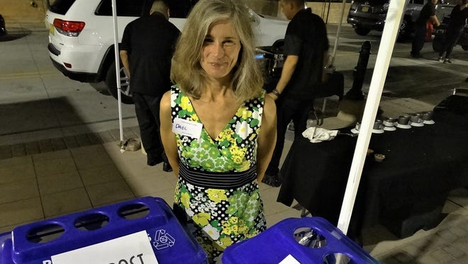 SWEC Planning Committee volunteer Dael Goodman with clearly marked clearstream containers that were visible and available at the 2017 SWEC Gala, sending the clear message of environmental awareness.