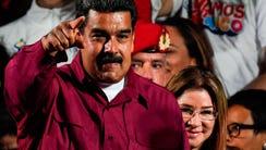 Venezuelan President Nicolas Maduro celebrates with