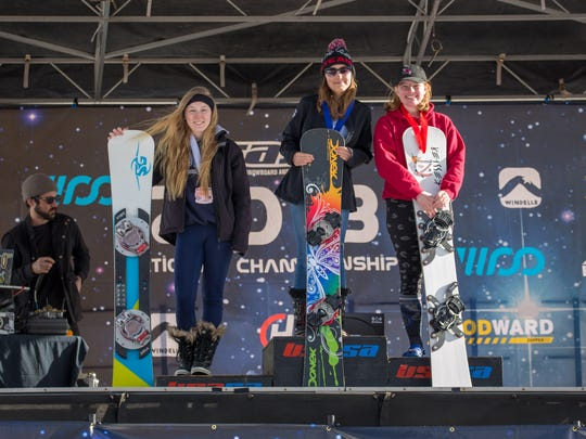Shasta High student Sage Will (left) poses after earning a bronze medal out of 22 competitors in the  snowboard slalom for the junior women's division at the Snowboard Nationals Tournament in Copper Mountain, Colorado.