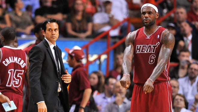 Heat coach Erik Spoelstra has made a point of reducing star LeBron James' minutes this season.