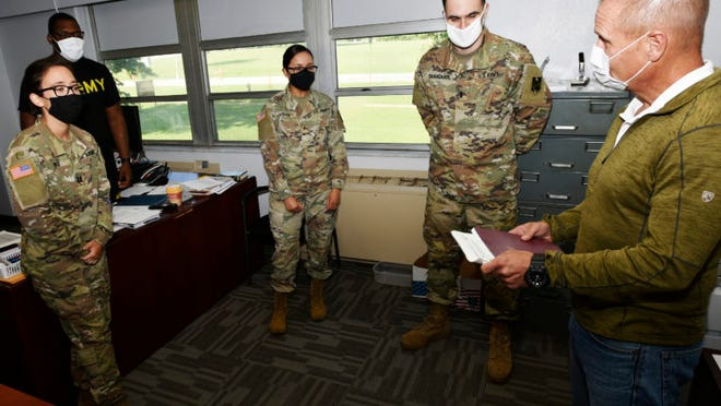 Gary Chura (right), leads weekly meetings with his legal assistance team as a forum to share thoughts and success stories. Chura, a Missouri attorney for 27 years and an Army Reserve judge advocate, has led the Fort Leonard Wood legal assistance office since February 2018. The team was named a fiscal year 2019 winner of the U.S. Army Chief of Staff Award for Excellence in Legal Assistance Aug. 6. It was the second-consecutive year the installation's legal assistance team has been honored with this award.