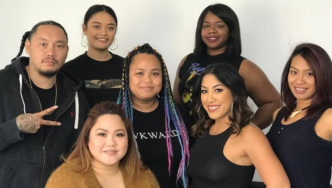 Fresh Impression owner R.T. Tingson, top left, and sister Maria Borja, bottom left, followed in their late mother's footsteps and became hairstylists. The pair are joined by the Fresh Impression stylists team in April 2018.