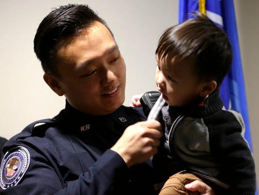 636149087785042512-111516-jrb-Hmong-officer-in-Rapids029.jpg