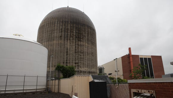 The exterior containment dome and the turbine hall,