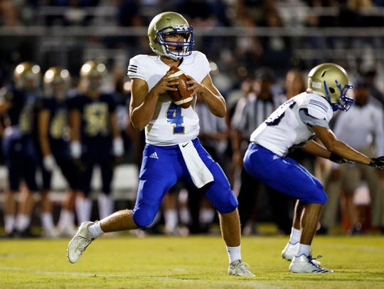 Brentwood quarterback Carson Shacklett drops back to