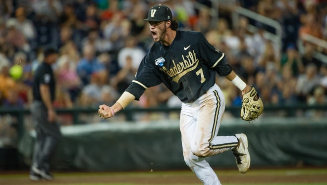 Jun 25, 2014: Vanderbilt Commodores infielder Dansby Swanson (7) celebrates an inning ending play in the eighth inning against the Virginia Cavaliers during game three of the College World Series Finals at TD Ameritrade Park Omaha. Vanderbilt defeated Virginia 3-2 to win the College World Series.