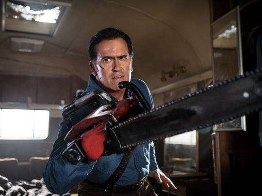 Ash Williams (Bruce Campbell) and his chainsaw hand