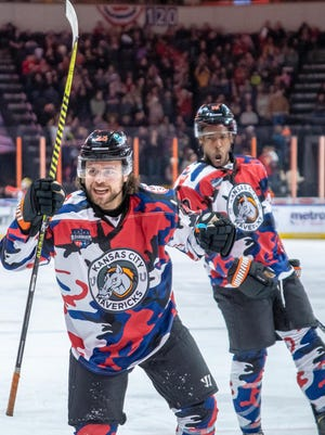 Forward C.J. Eick, front, celebrating a goal in a game last season, has signed to play a fourth year with the Kansas City Mavericks, joining teammate Greg Betzold and four others as the only players to spend four or more seasons with the franchise.