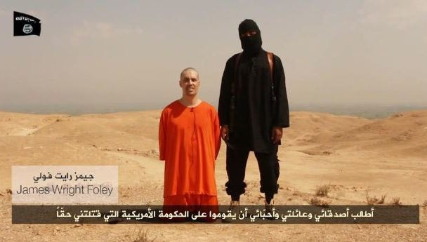 Image from video released by Islamic State militants appears to show the beheading of James Foley, a U.S. photojournalist who was kidnapped in Syria in November 2012.