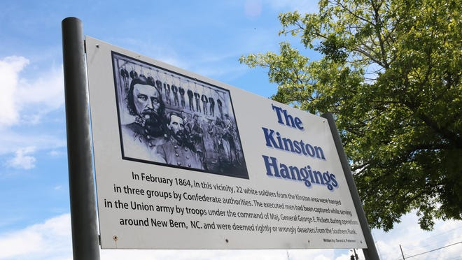 The Kinston Hangings sign, located in the 100 block of South McLewean Street behind the Lenoir County Courthouse in the vicinity of the actual hangings in 1864.