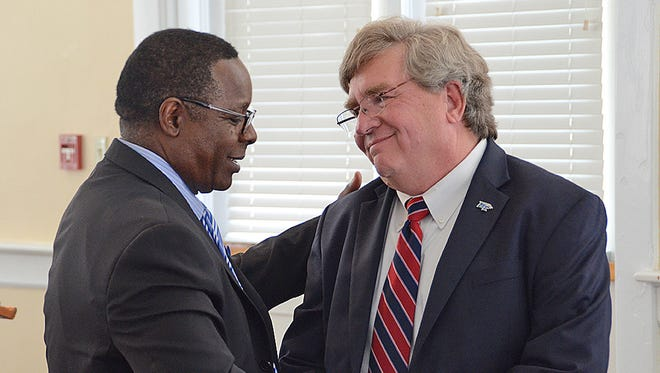 MTSU President Sidney A. McPhee, left, gives words of thanks to outgoing University College Dean Mike Boyle before a reception in Boyle's honor held Aug. 26, 2015, in the Tom H. Jackson Building. Boyle's last day as dean was Aug. 31 as he transitions back to a faculty position.