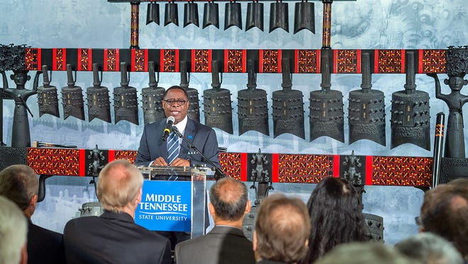 Sidney McPhee, MTSU President speaking at the Grand Opening dedication ceremony for the Chinese Music and Cultural Center in the Miller Education Center with guest speakers, visiting dignitaries, a musical bell performance, and ribbon cutting.