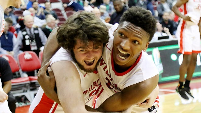 Daniel Daily, left, and Damani McEntire can't contain their joy after the Wildcats won the Division III state championship, 67-57 over Africentric March 24, 2018.