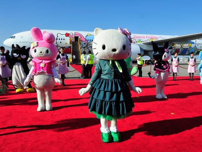 Performers dressed as Hello Kitty characters celebrate the arrival of the EVA Boeing 777-300ER Hello Kitty Jet on Sept. 18, 2013, at Los Angeles International Airport. Hello Kitty is celebrating her 40th birthday.