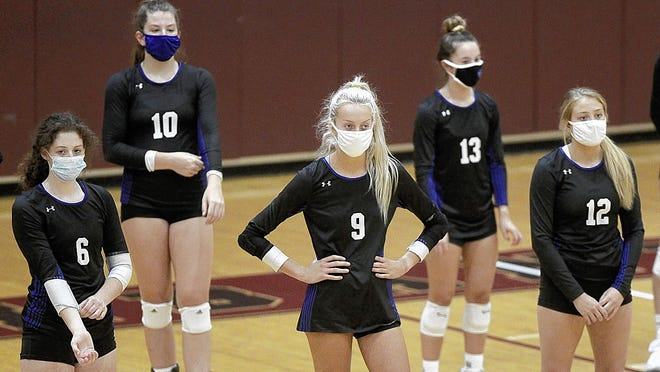 Worthington Kilbourne girls volleyball players Grace Cummings (left), Lily Podolan, Lauren Bair, Emily Cline and Natalie Helmbright wear masks during introductions before a match at New Albany on Aug. 22. Fall sports are underway in Ohio, with strict protocols in place for teams and spectators because of the COVID-19 coronavirus pandemic.