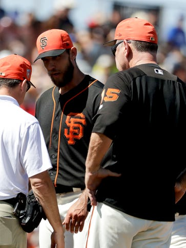 Giants starting pitcher Madison Bumgarner, center,