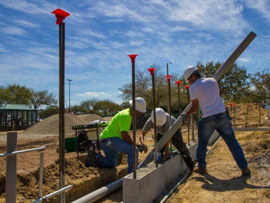 Technicians with Collier Electric of Fort Myers install
