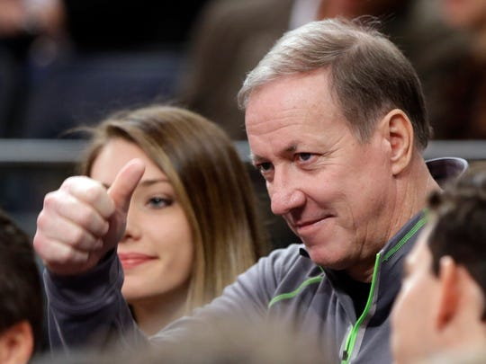 Jim Kelly gestures during the first half a New York Knicks game in April.