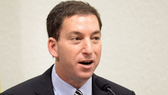 The Guardian's Brazil-based reporter Glenn Greenwald, who was among the first to reveal Washington's vast electronic surveillance program, testifies before  the investigative committee of the Senate that examines charges of espionage by the United States  in Brasilia on Oct. 9, 2013.