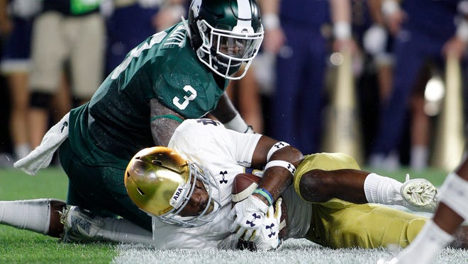 Notre Dame's Shaun Crawford recovers a fumble in the end zone for a touchback after stripping Michigan State's LJ Scott in the second quarter Saturday, Sept. 23, 2017 in East Lansing.