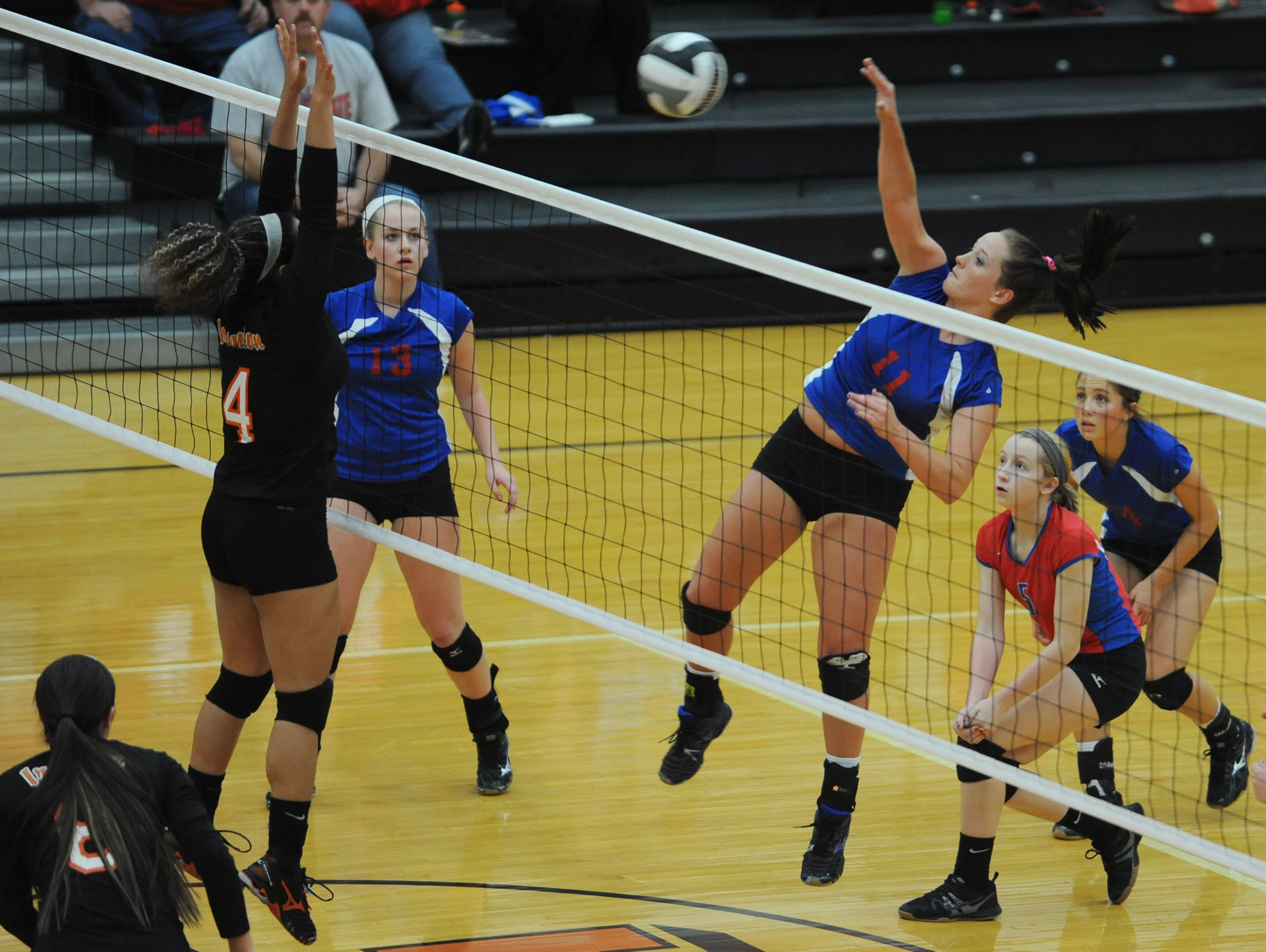 Zane Trace's Katie Unger hits the ball over the net past an Ironton opponent Wednesday at Waverly High School. Zane Trace defeated Ironton 3-1.