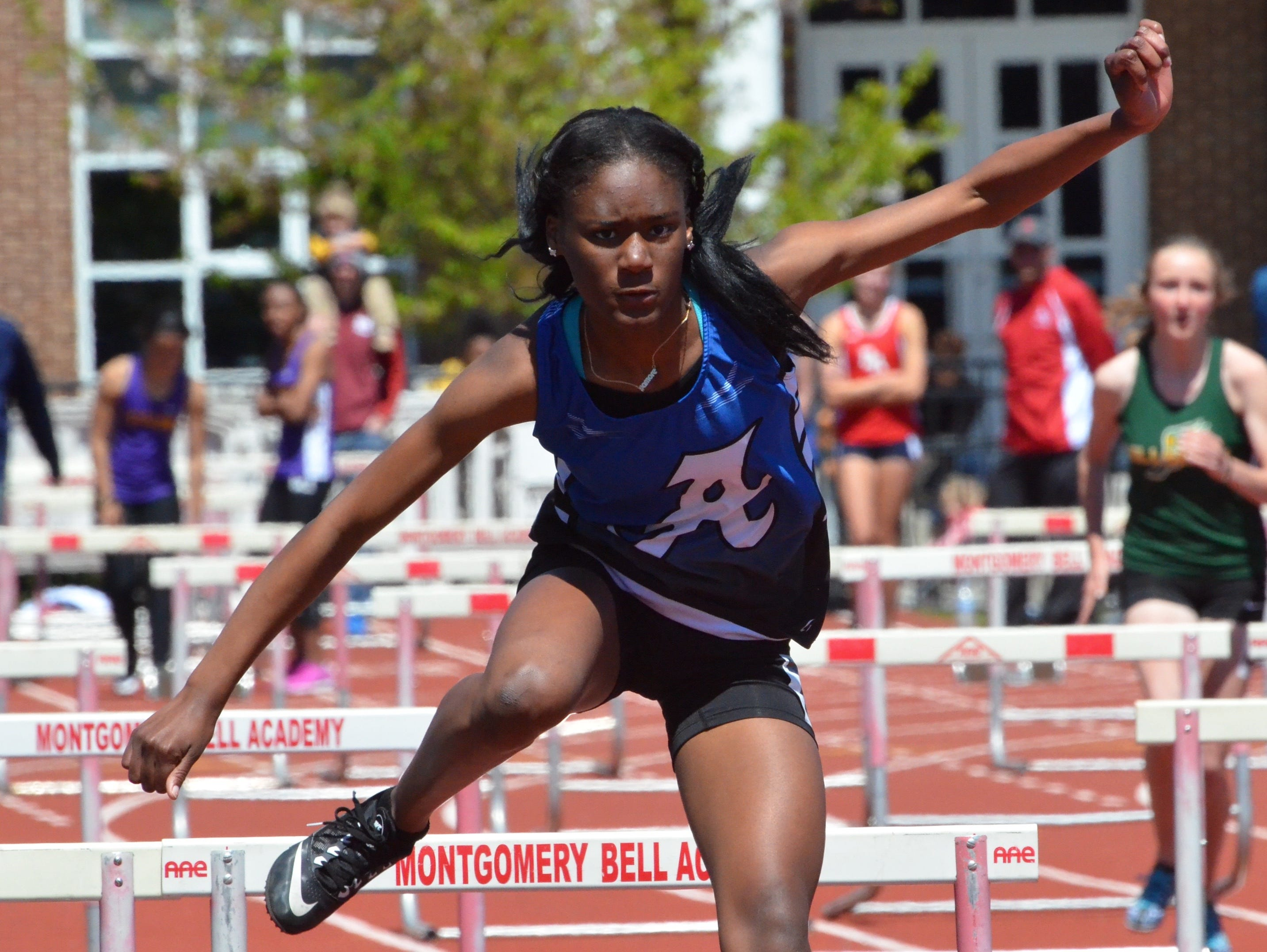 Antioch's Fayonica Holt competes in the hurdle shuttle relay at Saturday's Doug Hall Relays at Mongomery Bell Academy.