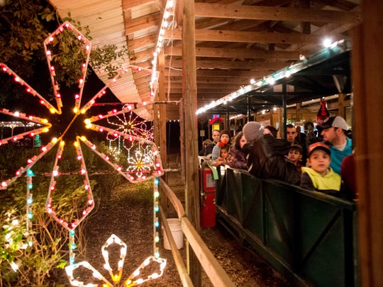 The tour train drives away from the train depot during the Safari of Lights at Zooisiana Zoo of Acadiana in Broussard, La., Sunday, Dec. 21, 2014. The Safari of Lights is held annually at the zoo during the holiday season with lighted displays near animal habitats.