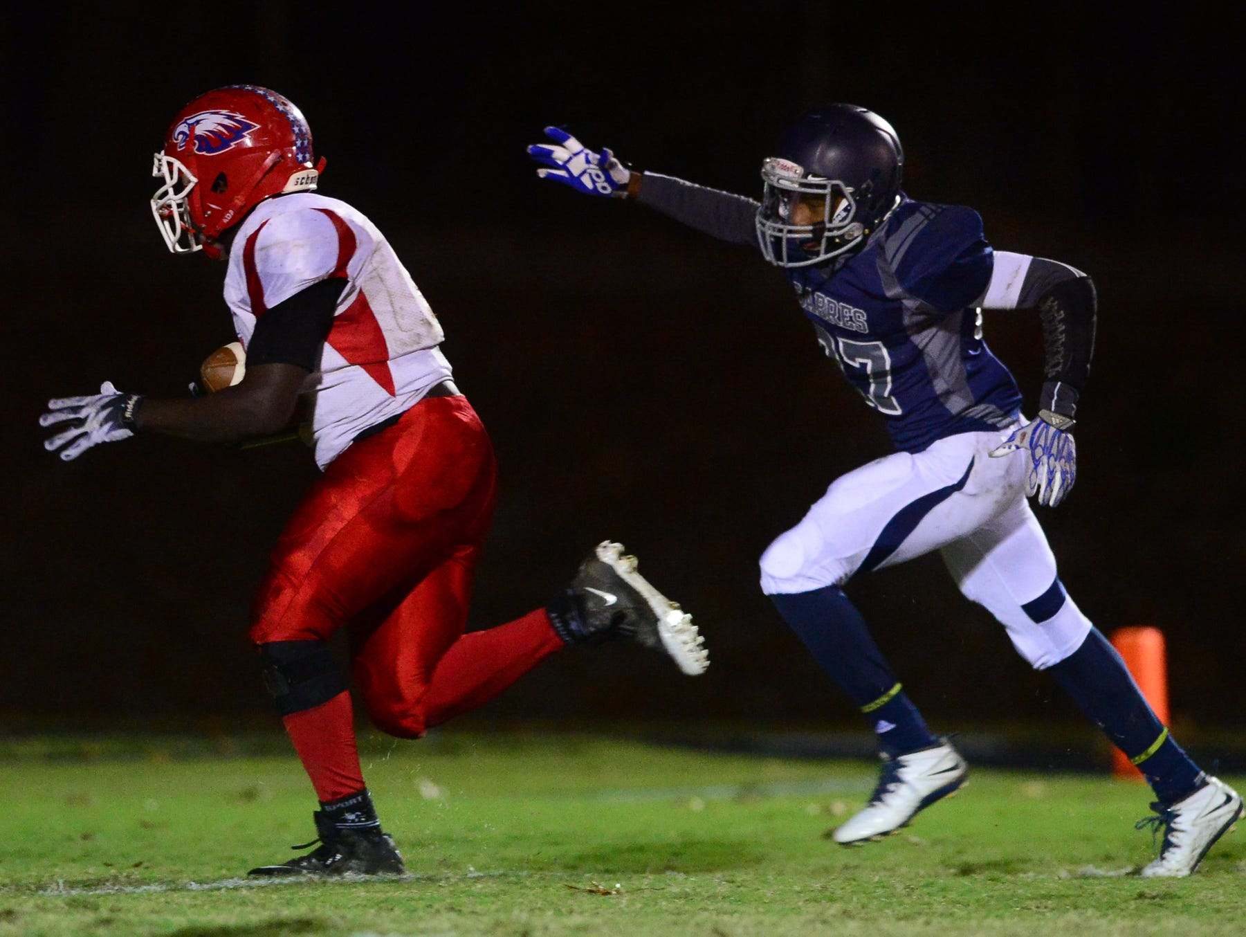 Southside Christian's Austin Greer (27) runs down Wagener-Salley's Napoleon Posey (5) during a football game at Southside Christian on Friday.