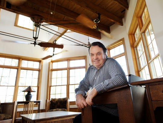 Jay McGinnis sits in a living area of his Fawn Township