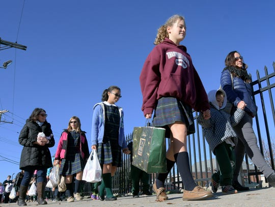 In this file photo, St. Patrick School students walk to Our Daily Bread while delivering items collected in the school's food drive in November 2015. The Diocese of Harrisburg announced the York City Catholic School will be merging with St. Joseph School-Dallastown at the end of the current school year.